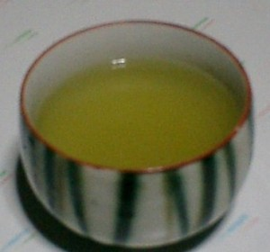 A bowl of Green Tea for Budwig Diet ready to drink without sugar of milk