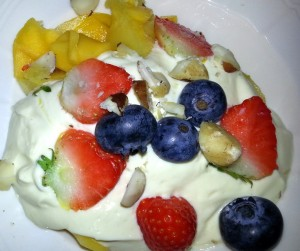 Eton mess style Budwig cream-muesli with mango, berries, nuts and ground linseed